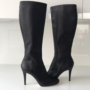 Jimmy Choo knee high boots with platform.